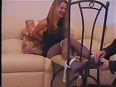 Brunette in bondage geer is hung from the ceiling by her hands and feet 2